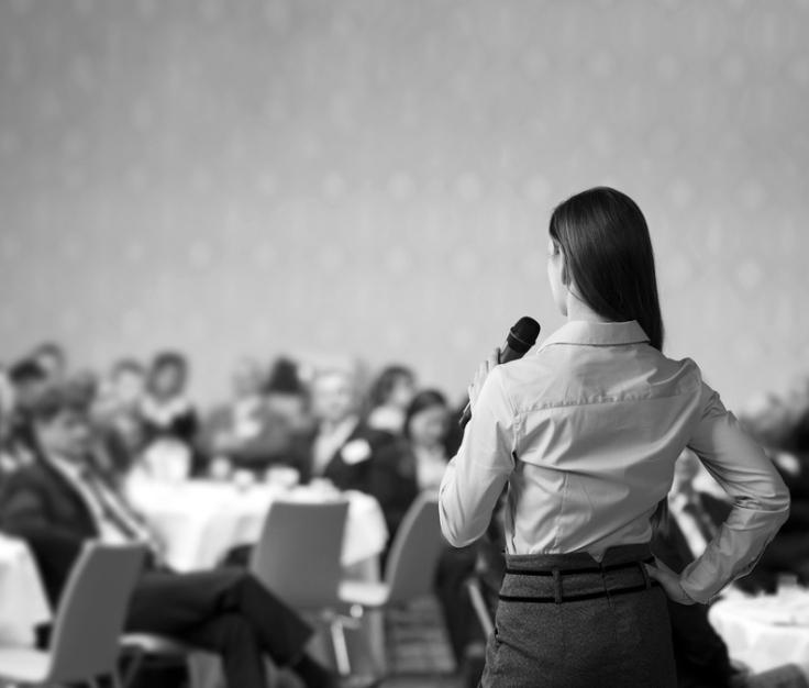 Woman-Speaking-Office